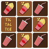 Tic-Tac-Toe of beverages cup with straw and popcorn Royalty Free Stock Photos