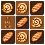 Tic-Tac-Toe of bread and cinnamon roll. Illustration of  of bread and cinnamon roll in tic-tac-toe game Stock Photo