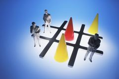 Tic-Tac-Toe with Businessman Figures royalty free stock images