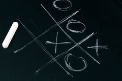 Tic tac toe chalk on a  school blackboard dark Stock Photography