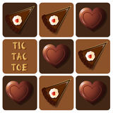 Tic-Tac-Toe of chocolate and cake Royalty Free Stock Images