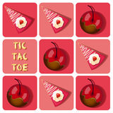 Tic-Tac-Toe of  chocolate covered cherry and strawberry cake Royalty Free Stock Image