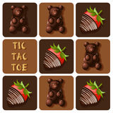 Tic-Tac-Toe of chocolate covered strawberry and jelly gummy Royalty Free Stock Photography