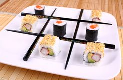 Tic tac toe from chopsticks and Sushi. Close up Stock Photo