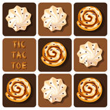 Tic-Tac-Toe of cinnamon roll and meringue Stock Photos