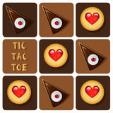Tic-Tac-Toe of cookie and cake Royalty Free Stock Images