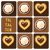 Tic-Tac-Toe of cookie and cup cake Stock Photos