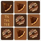 Tic-Tac-Toe of donut and chocolate tart Stock Images