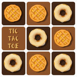 Tic-Tac-Toe of donut and pineapple pie Royalty Free Stock Image