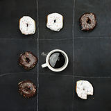 Tic Tac Toe Donuts and Coffee. Over black board background. Image shot from overhead Royalty Free Stock Images