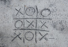 Tic-tac-toe drawing on sand Royalty Free Stock Image
