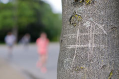 Tic-tac-toe drawing on tree Royalty Free Stock Image