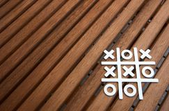 Tic Tac Toe game. On wooden surface Stock Photo