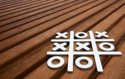 Tic Tac Toe game. On wooden surface Stock Images