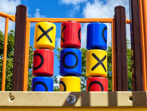 Tic-tac-toe game. In a kids playground on a nice summer day Royalty Free Stock Images