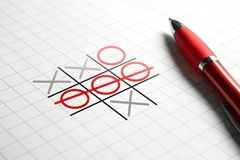 Tic tac toe game. Noughts and crosses. Paper and pen. Winning and success concept Stock Images