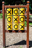 Tic-tac-toe game on the playground. In sunny weather stock image