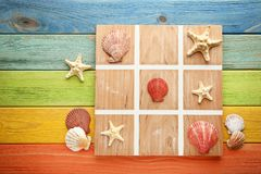 Tic tac toe game. By seashells and starfish Royalty Free Stock Photo