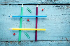 Tic tac toe game. On blue wooden table Royalty Free Stock Photos
