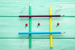 Tic tac toe game. On mint wooden table Royalty Free Stock Image