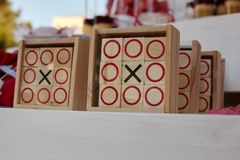 Tic-tac-toe game on white wooden background. Stock Photography