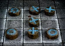 Tic tac toe game on wood pieces Royalty Free Stock Photos