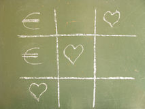 Tic-Tac-Toe love euro. Tic-Tac-Toe love against money and win the love stock photography