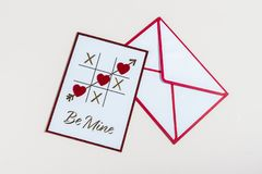 Tic Tac Toe love letter for valentines day with be mine message. Love letter for valentines day with be mine message white background tick tac toe arrow heart stock photos