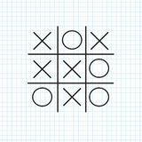 Tic tac toe. On the notebook sheet in a cage Stock Images