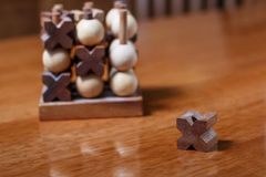 Tic-tac-toe or noughts and crosses game. In wooden stick standing Royalty Free Stock Photography