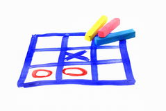 Tic tac toe and piece of chalk Stock Photo