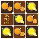 Tic-Tac-Toe of pineapple juice and orange juice Royalty Free Stock Image