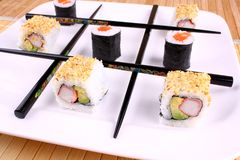Tic tac toe play with chopsticks and sushi Stock Photos