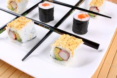 Tic tac toe play with sushi and chopsticks. Close up Royalty Free Stock Images