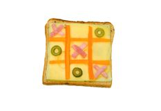 Tic tac toe sandwich. Fresh bread, two kinds of cheese, ham and green olives Stock Image