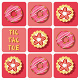 Tic-Tac-Toe of strawberry tart and donut Stock Photos