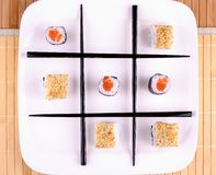 Tic tac toe from Sushi and chopsticks. Top view Royalty Free Stock Images