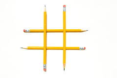 Tic-Tac-Toe Symbol with Yellow Pencils Stock Images