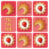 Tic-Tac-Toe of tart and croissant Royalty Free Stock Photos