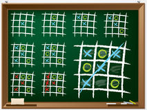 Tic tac toe variations on chalkboard Stock Images