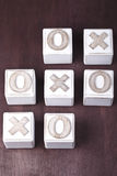 Tic-tac-toe. A Tic-tac-toe on wooden cubes Royalty Free Stock Image