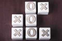 Tic-tac-toe. A Tic-tac-toe on wooden cubes Stock Photography