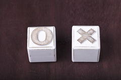 Tic-tac-toe. A Tic-tac-toe on wooden cubes Royalty Free Stock Images