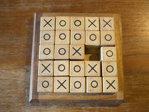 Tic Tac Toe. Wooden game on the wooden table Stock Image