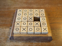 Tic Tac Toe. Wooden game on the wooden table Royalty Free Stock Image