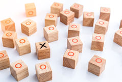 Tic tac toe XO game. Wood Toys,wooden block with x and o inside creativity ideas concept Royalty Free Stock Photo