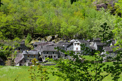 Ticino mountain village. Village in the woods consisting of old houses put together from rough stone situated in valley of Bavona which is said to be the wildest Stock Images