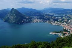 Ticino: panoramic view from Mount Bré to the city of Lugano and. Mount San Salvadore Royalty Free Stock Images