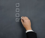 Tick box. Tick in the box on a chalk board Royalty Free Stock Photo
