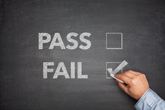 Tick boxes for Pass or Fail on blackboard Stock Photo